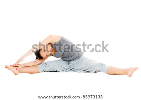 young woman doing stretch exercise on floor. isolated on white background - stock photo