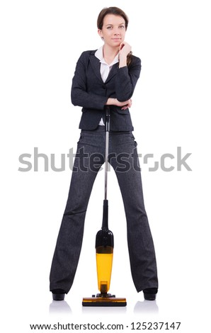 Young woman doing vacuum cleaning - stock photo