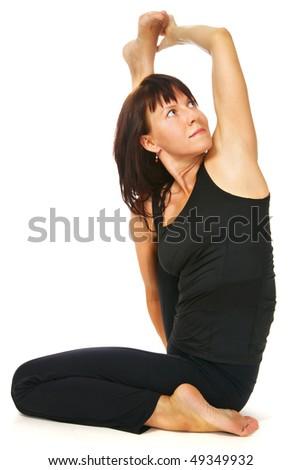 young woman doing yoga exercise - stock photo