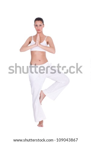 Young woman doing yoga exercise, isolated on white background - stock photo