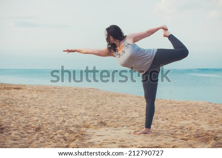 Young woman doing yoga exercise outdoors - stock photo