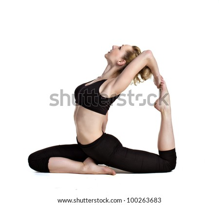 young woman doing yoga exercises isolated on white - stock photo