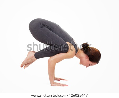 Young woman doing yoga isolated on white - stock photo