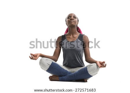 Young woman doing yoga sport exercises isolated on white - stock photo