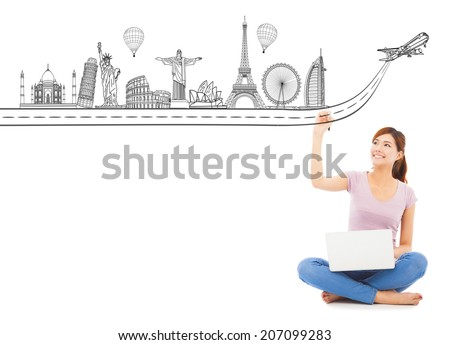 young woman drawing a travel trip landmark - stock photo