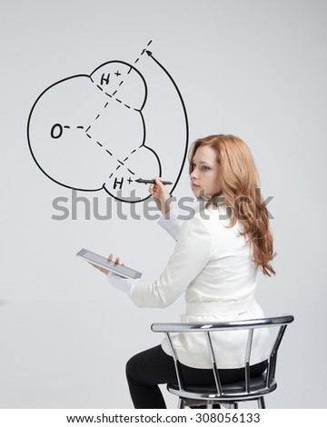 Young woman draws water molecule - stock photo