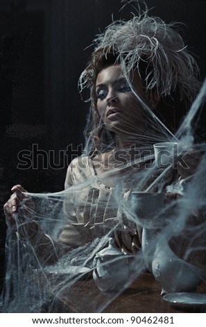 Young woman drinking coffee in old interior - stock photo