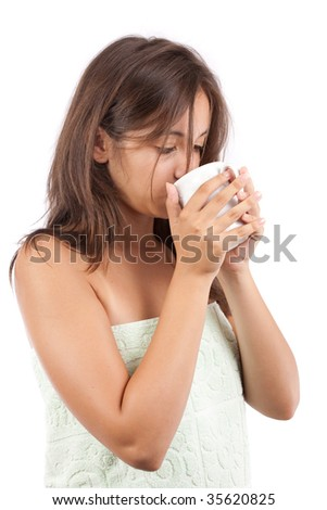 Young woman drinking coffee in the morning, after shower - stock photo