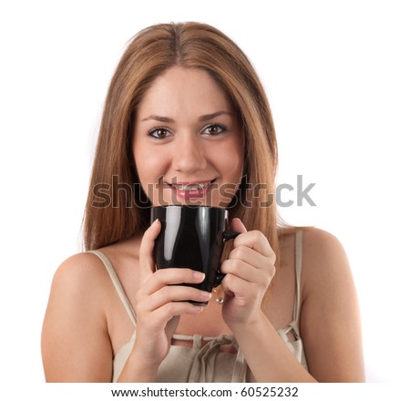 Young woman drinking from a cup,isolated on white - stock photo