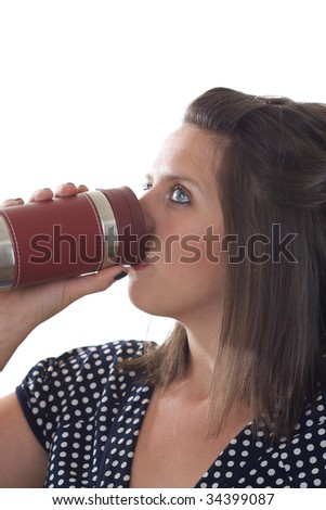 Young woman drinking from mug; close-up isolated on a white background. - stock photo