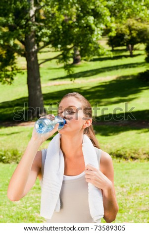 Young woman drinking water - stock photo