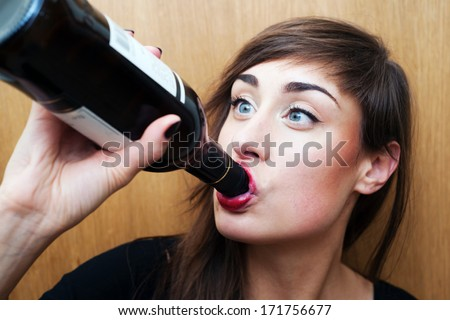 Young woman drinking wine - stock photo