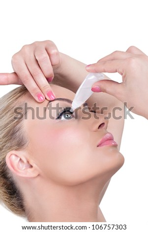 Young woman dripping eyes, eyes care - stock photo