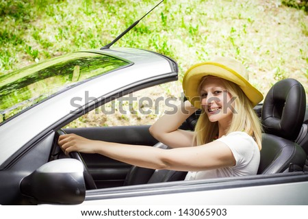 Young woman driving a car. - stock photo