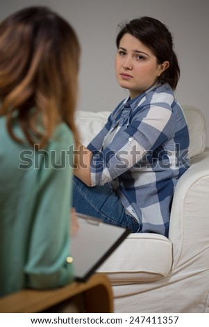Young woman during psychotherapy session at home - stock photo