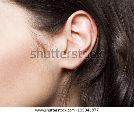 Young woman ear - stock photo