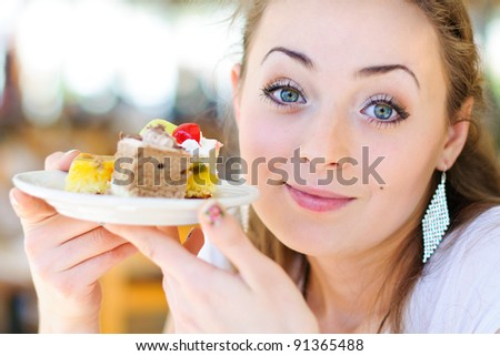 Young woman eat dessert - stock photo