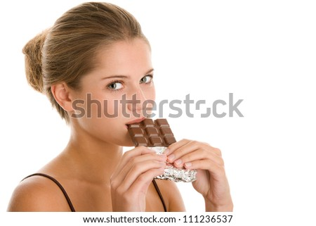 Young woman eating chocolate - stock photo
