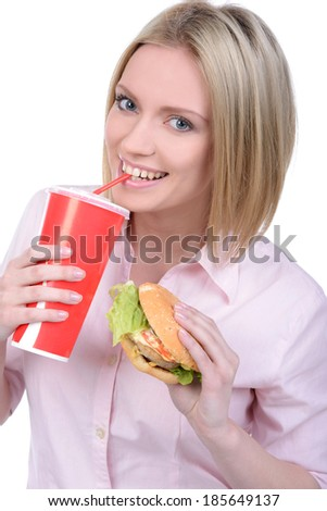 Young woman eating fast food isolated on white background - stock photo