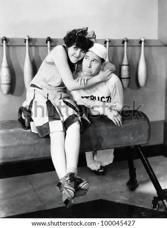 Young woman embracing a young man on a pommel horse - stock photo