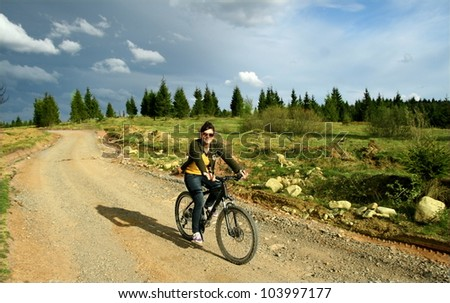 Young woman enjoy a mountain bike trip. Outdoor activity - stock photo