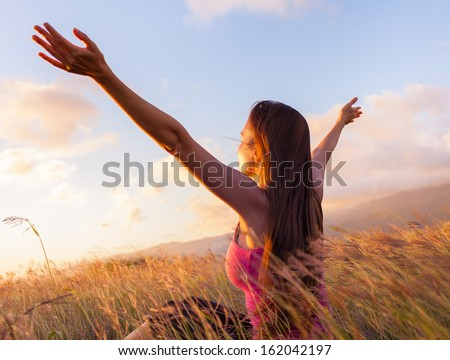 Young woman enjoy sunshine in wheat field   - stock photo