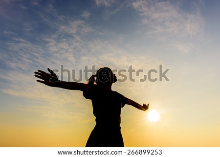 Young woman enjoying beautiful - stock photo