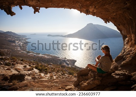 Young woman enjoying beautiful view at sunset - stock photo