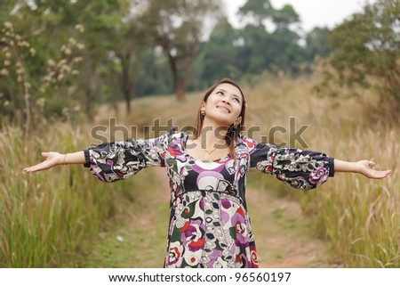 young woman enjoying breathing in wild nature, thailand - stock photo