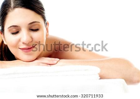 Young woman enjoying her spa - stock photo