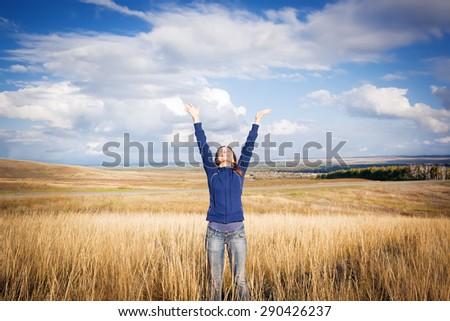 young woman enjoying nature - stock photo