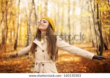 Young woman enjoying nature at autumn  - stock photo