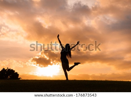 Young woman enjoying sunset in Hawaii. Freedom concept. - stock photo