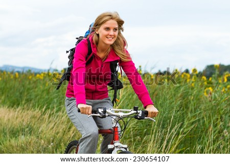 Young  woman enjoys riding a bicycle,Cycling - stock photo