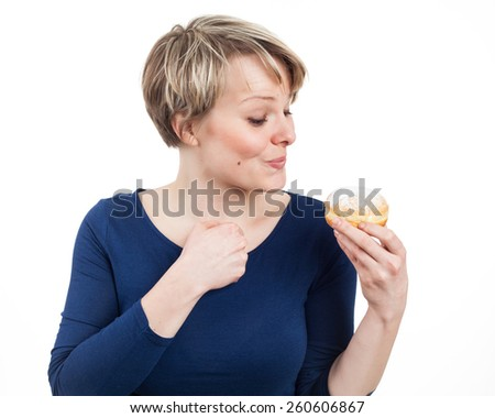 Young woman excited about a donut, isolated on white - stock photo