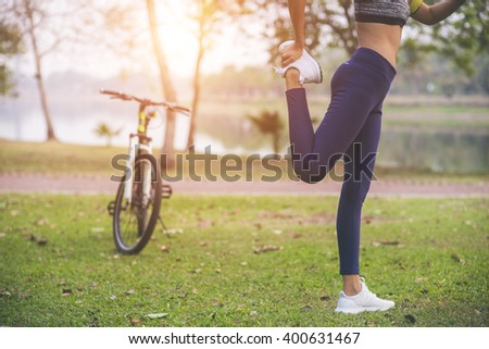 young woman, exercise in gardent background - stock photo