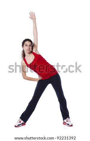 Young woman exercising and stretching (isolated on white) - stock photo