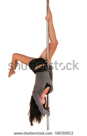 Young woman exercising pole dance fitness - stock photo