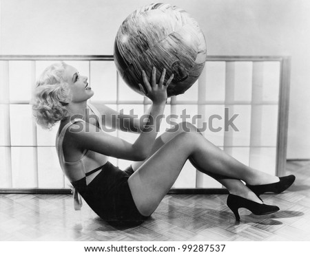 Young woman exercising with a big ball - stock photo