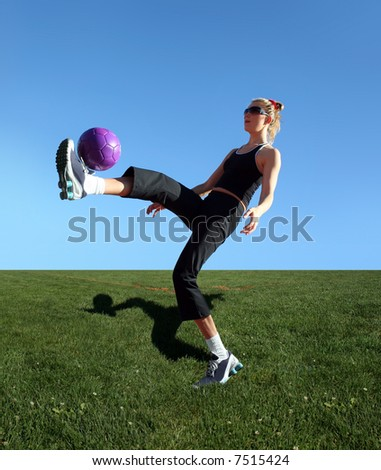 Young woman exercising with the ball in a park - stock photo