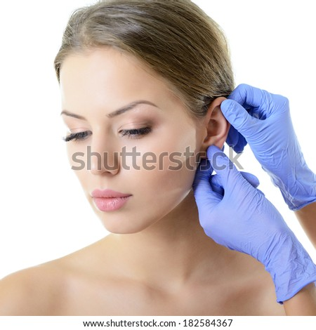 Young woman face with beauty treatment ear plastic isolated  - stock photo
