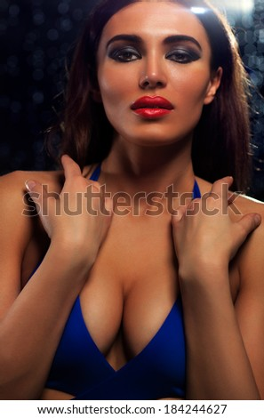 Young woman fashion portrait on dark background. - stock photo