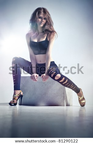 Young woman fashion. Soft blue tint. - stock photo