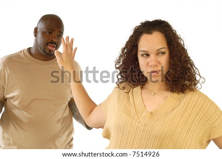 "Young woman fed up with the nonsense coming out of her boyfriend's mouth as he's trying to explain ""what happened"" - stock photo"