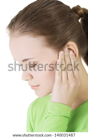 Young woman feeling a pain in ear,isolated on white background - stock photo