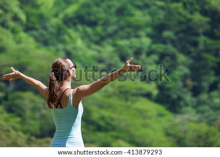 Young woman feeling free enjoying the great outdoors.  - stock photo