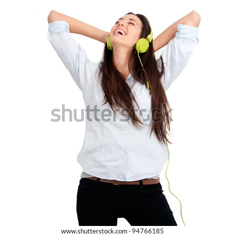 Young woman feeling happy listening music with headphones.Isolated. - stock photo