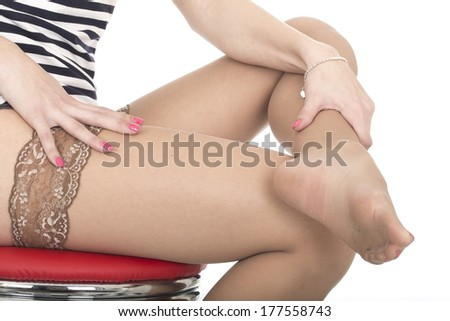 Young Woman Feet in Stockings - stock photo