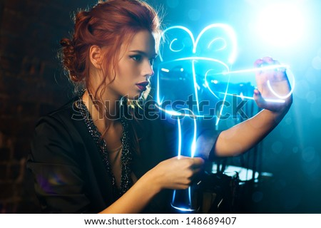 Young woman film director with virtual camera. - stock photo