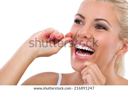 Young woman flossing her teeth , close up , isolated on white background - stock photo